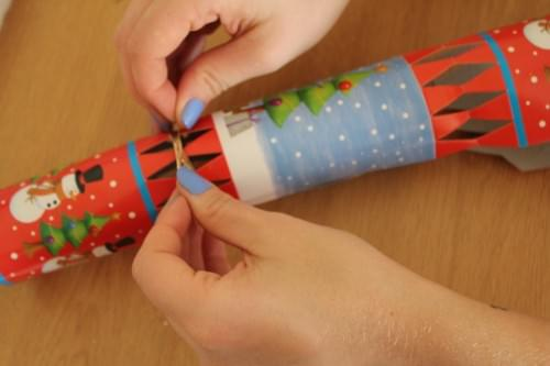 Tie the Ribbon around the end of the cracker